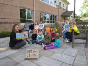 preschool-reading-in-garden